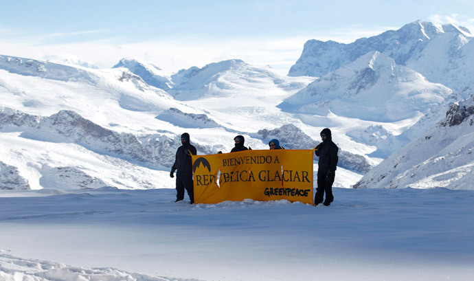 "Greenpeace activists hold up a banner that reads, ""Welcome to Republica Glaciar (Glacier Republic)"" during its symbolic founding, some 5,000 meters (16,404 ft.) above sea level, at Los Andes Mountain range, near Santiago city, March 2, 2014.(Reuters / Ivan Alvarado )"