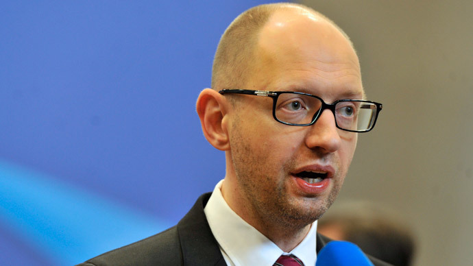 Ukrainian Prime Minister Arseniy Yatsenyuk holds a press conference at the EU headquarters in Brussels on March 21, 2014 on the second day of a two-day European Council summit.(AFP Photo / Georges Gobet)