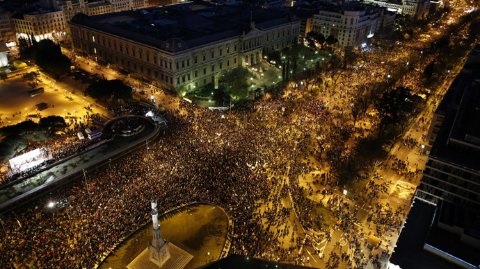 "Anti-austerity demonstrators crowd into Colon square as they take part in a demonstration which organisers have labelled the ""Marches of Dignity"" in Madrid, March 22, 2014. (Reuters)"