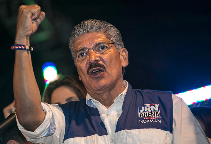 Salvadorean presidential candidate for the National Republican Alliance party, Norman Quijano waves at supporters after receiving the voting results during the presidential election run-off in San Salvador, on March 9, 2014 (AFP Photo / Inti Ocon)