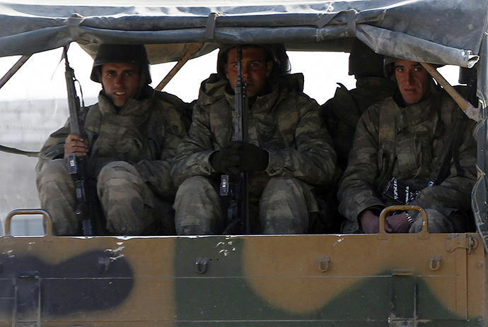 Turkish soldiers sit in a vehicle (Reuters / Amr Abdallah Dalsh)