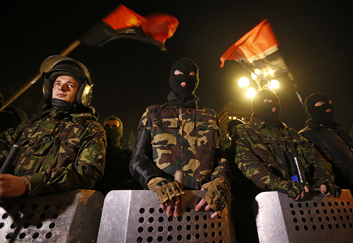 Activists of the Right Sector movement and their supporters gather outside the parliament building to demand the immediate resignation of Internal Affairs Minister Arsen Avakov, in Kiev March 27, 2014. (Reuters / Vasily Fedosenko)