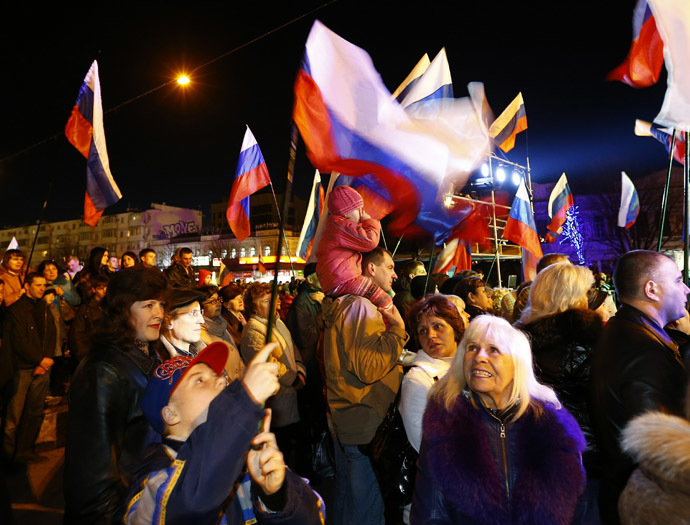 People attend celebrations on the main square of the Crimean city of Simferopol March 21, 2014. (Reuters)