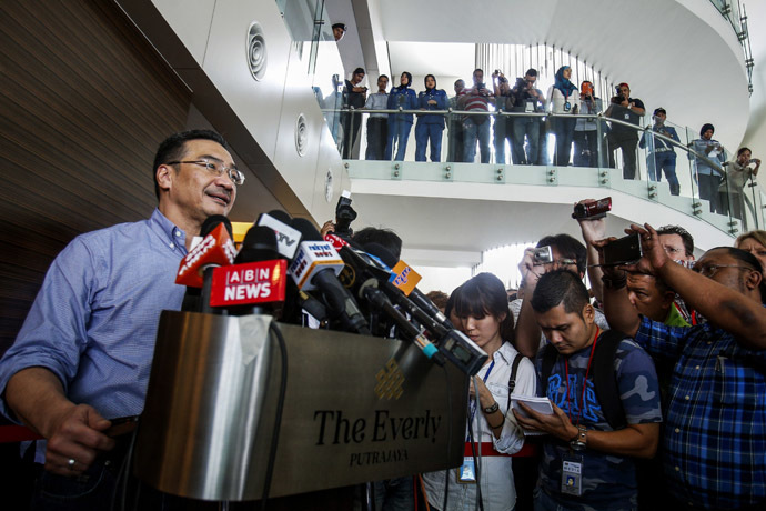 Malaysia's acting Transport Minister Hishammuddin Hussein (L) speaks about the search for the missing Malaysia Airlines Flight MH370 during a news conference at The Everly Hotel in Putrajaya March 29, 2014. (Reuters)