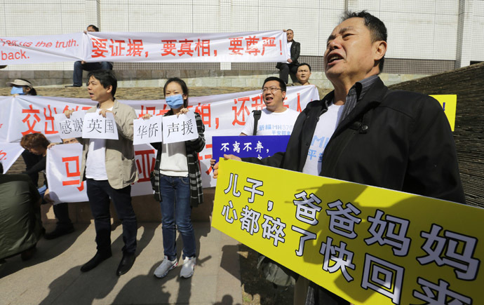 A family member of a passenger onboard the Malaysia Airlines Flight MH370 shouts slogans during a protest outside Lido Hotel in Beijing March 29, 2014. (Reuters)