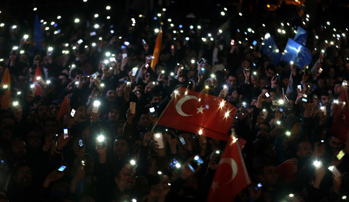 Supporters of Turkey's Prime Minister Tayyip Erdogan turn on their mobile phones as they celebrate their election victory in front of the party headquarters in Ankara March 31, 2014. (Reuters)