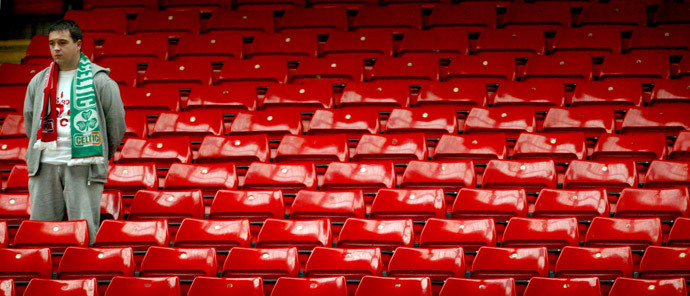A soccer fan stands in the Kop during a ceremony to mark the 15th anniversary of the Hillsborough disaster at Liverpool's Anfield stadium, April 15, 2004. (Reuters / Darren Staples)