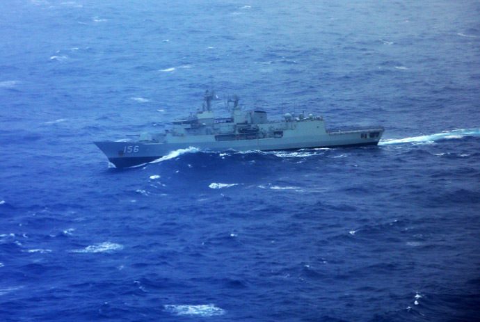 Australian Navy ship HMAS Toowoomba is seen from the Japan Coast Guard Gulfstream V aircraft as it flies over the southern Indian Ocean as they look for debris from missing Malaysian Airlines flight MH370 April 1, 2014. (Reuters)