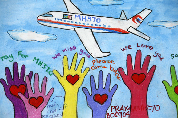An artwork conveying well-wishes for the passengers and crew of the missing Malaysia Airlines Flight MH370 is seen at a viewing gallery in Kuala Lumpur International Airport March 19, 2014. (Reuters)