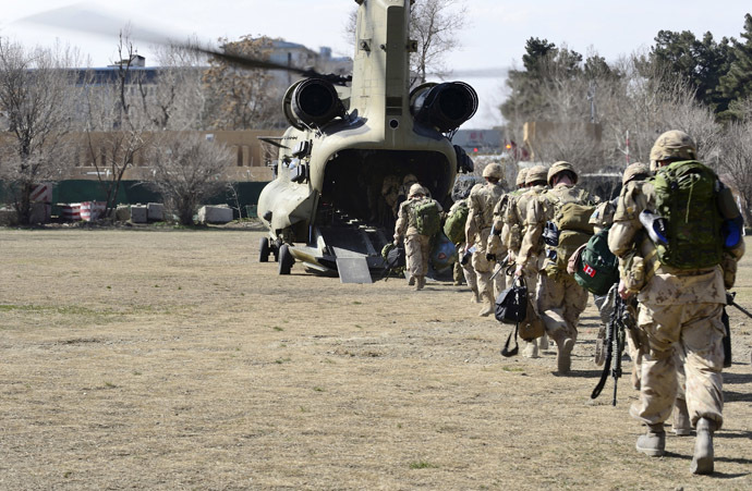 The last Canadians involved in the NATO training mission in Afghanistan board a U.S. Chinook helicopter as they leave the International Security Assistance Force (ISAF) headquarters in Kabul, Afghanistan March 12, 2014. (Reuters)