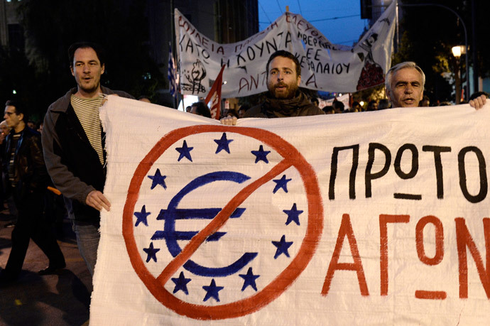 Protesters hold a banner during a demonstration trying to reach the venue of an Informal Meeting of EU Ministers for Economic and Financial affairs in Athens on April 1, 2014. (AFP Photo / Louisa Gouliamaki)