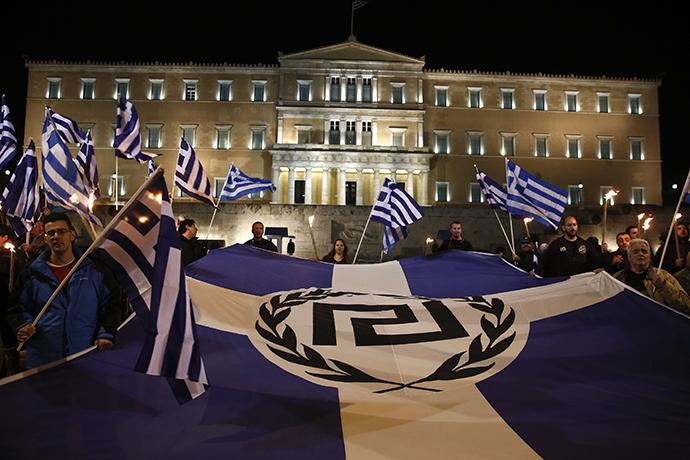 Supporters of Greece's far-right Golden Dawn party protest around a flag during a rally at central Syntagma square in Athens (Reuters / Yorgos Karahalis)