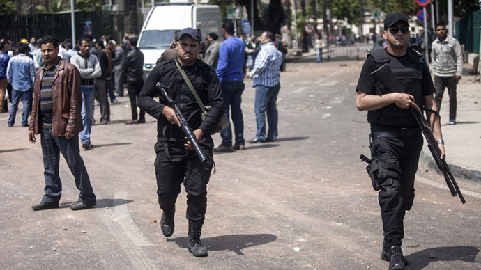 Egyptian security patrol the area after twin bombs struck police posts near Cairo University in the centre of Egypt's capital on April 2, 2014, which was followed by a third blast as police and journalists gathered at the scene. (AFP Photo / Mahmoud Khaled)