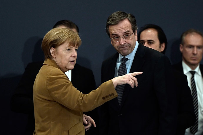 German Chancellor Angela Merkel talks with Greece's Prime minister Antonis Samaras (R) upon their arrival for a meeting with Greek young businessmen in a hotel in Athens on April 11, 2014. (AFP Photo / Louisa Gouliamaki)