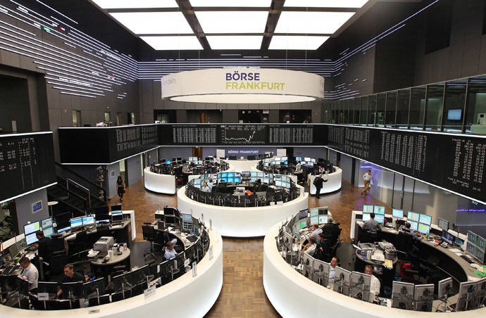 Traders work at the stock exchange in Frankfurt am Main, western Germany (AFP Photo / Daniel Roland)