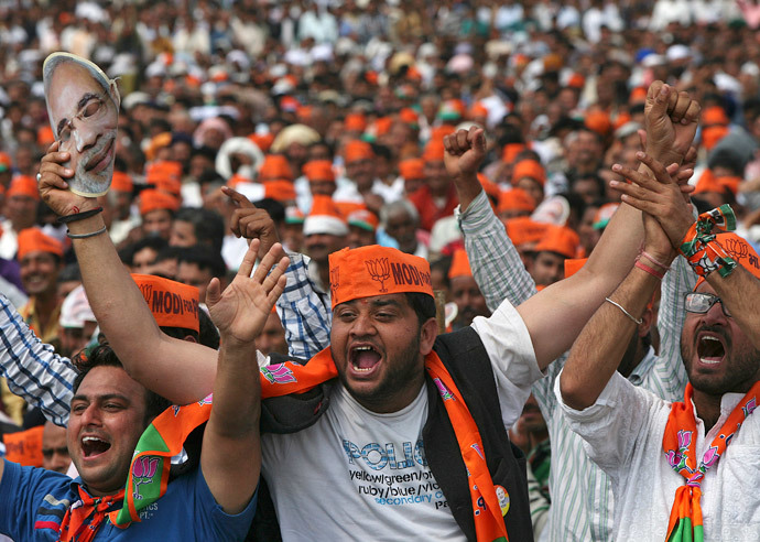 Supporters of Hindu nationalist Narendra Modi, prime ministerial candidate for India's main opposition Bharatiya Janata Party (BJP) and Gujarat's chief minister, cheer as they listen to Modi during a rally in Hiranagar March 26, 2014. (Reuters / Mukesh Gupta)