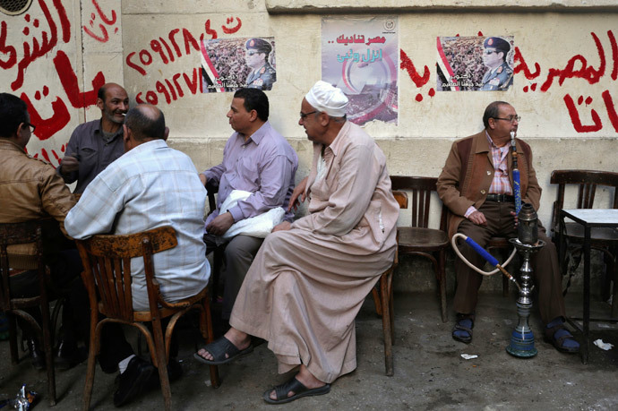 People sit at a cafe near posters of presidential candidate and former Egyptian army chief Field Marshal Abdel Fattah al-Sisi in central Cairo. (Reuters / Asmaa Waguih)
