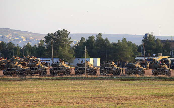 Tanks are positioned at a military base on the Turkish-Syrian border (Reuters)