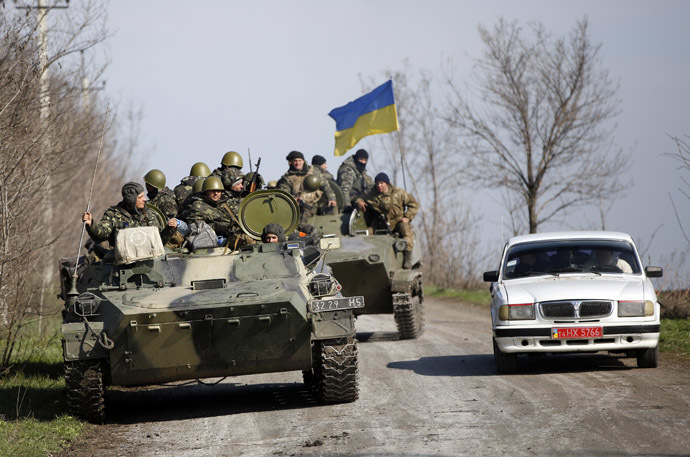 Ukrainian soldiers drive on an airborne combat vehicle near Kramatorsk, in eastern Ukraine April 16, 2014. (Reuters/Marko Djurica)