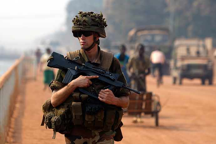 A French peacekeeping soldier patrols a street of the capital Bangui January 18, 2014 (Reuters / Siegfried Modola)