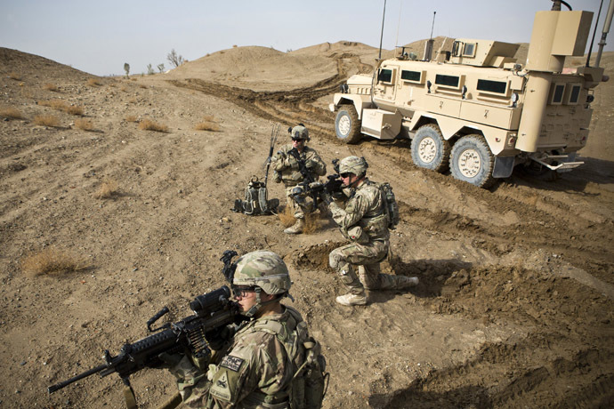 U.S. Army soldiers with Charlie Company, 36th Infantry Regiment, 1st Armored Division set up a supportive position during a mission near Command Outpost Pa'in Kalay in Maiwand District, Kandahar Province February 3, 2013. (Reuters/Andrew Burton)