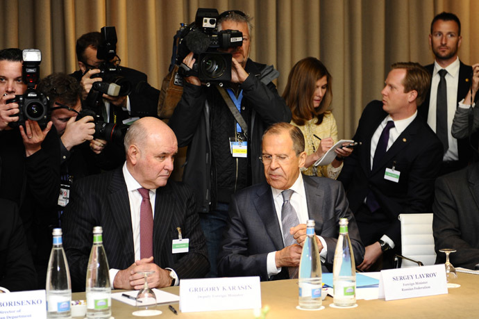 Russia's Foreign Minister Sergei Lavrov (seated R) and Russia's Deputy Foreign Minister Grigory Karasin attend a meeting in Geneva, between representatives from Ukraine, the European Union, Russia and the U.S. on the crisis in Ukraine April 17, 2014. (Reuters/Alain Grosclaude)
