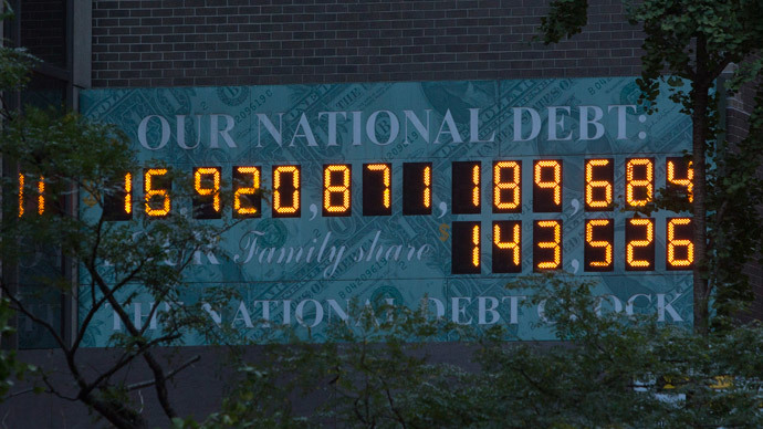 The national Debt Clock is seen in New York October 15, 2013. (Reuters / Andrew Kelly)