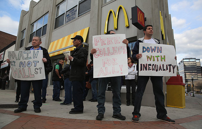 Activists protest for higher wages and free higher education outside a McDonald's restaurant on April 8, 2014 in Stamford, Connecticut. (AFP Photo / Getty Images / John Moore)