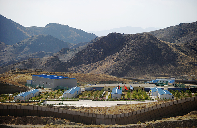 A camp set up by the Chinese mining company sits mostly empty near a protective wall a few kilometers away from an ancient Buddhist site where a religious community set up more than 17 centuries ago to exploit the copper deposits in the arid mountains of Mes Ainak on October 10, 2012. (AFP Photo / Roberto Schmidt)