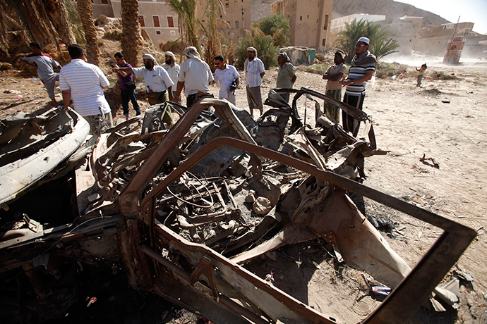 ARCHIVE PHOTO: People talk to human rights activists next to debris left by a U.S. drone air strike that targeted suspected al Qaeda militants in August 2012, in the al-Qatn district of the southeastern Yemeni province of Hadhramout February 5, 2013 (Reuters / Khaled Abdullah)