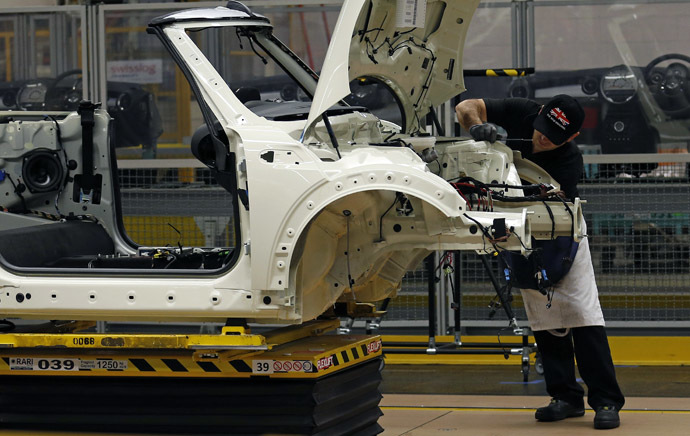 An employee works on a 2013 Mini at BMW's plant in Oxford, southern England (Reuters/Suzanne Plunkett)