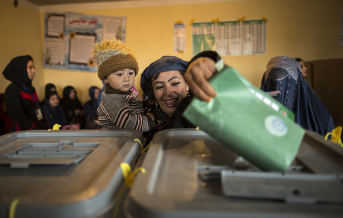 An Afghan woman casts her ballot at a polling station in Mazar-i-Sharif April 5, 2014. (Reuters/Zohra Bensemra)