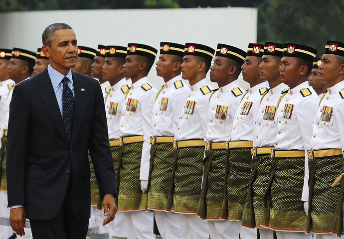 U.S. President Barack Obama inspects an honor guard during a welcoming ceremony at Parliament Square in Kuala Lumpur April 26, 2014. (Reuters)