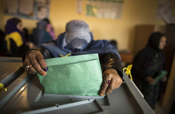 An Afghan woman casts her ballot at a polling station in Mazar-i-Sharif April 5, 2014. (Reuters)
