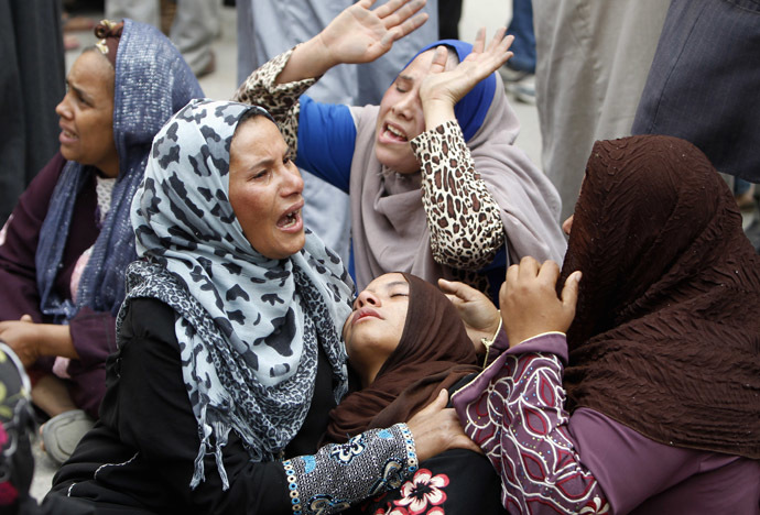 Relatives and families of members of Muslim Brotherhood and supporters of ousted President Mohamed Mursi react after hearing the sentence, in front of the court in Minya, south of Cairo, April 28, 2014. (Reuters)
