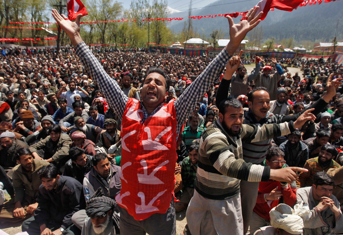 A supporter of Kashmir's ruling National Conference (NC) party, wearing a vest with images of ploughs, shouts slogans during an election campaign rally being addressed by Farooq Abdullah, the president and a candidate of NC, in Kangan, east of Srinagar, April 28, 2014. (Reuters / Danish Ismail)