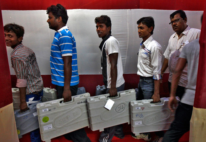 Workers carry electronic voting machines (EVM) at an election material distribution centre ahead of the seventh phase of the general election at Howrah district in the eastern Indian state of West Bengal April 29, 2014. (Reuters / Rupak De Chowdhuri)