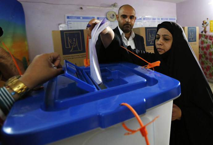 A resident casts her vote at a polling station during parliamentary election in Baghdad April 30, 2014.(Reuters)