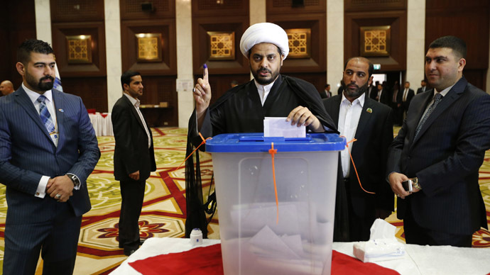 The first post-occupation election in Iraq started with explosions