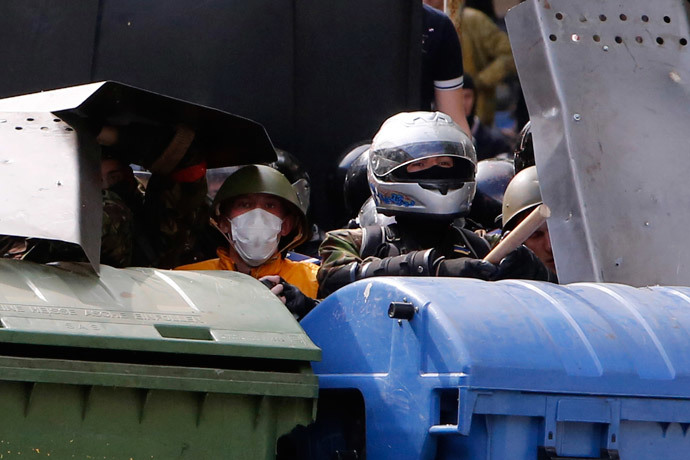Supporters of the Kiev government take cover during clashes with anti-government activists in the streets of Odessa May 2, 2014. (Reuters / Yevgeny Volokin)