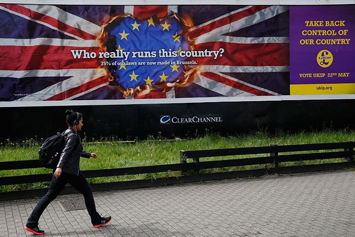 A pedestrian passes a United Kingdom Independence Party (UKIP) European elections campaign poster in Vauxhall, central London April 22, 2014 (Reuters / Luke MacGregor)