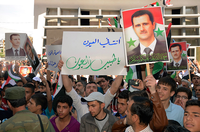Supporters of Syria's President Bashar al-Assad take part in a rally showing support a day after he declared that he would seek re-election in June, in Aleppo April 29, 2014 (Reuters)