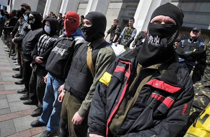 Supporters of the right wing party Pravyi Sector (Right Sector) protest in front of the Ukrainian Parliament in Kiev on March 28, 2014. (AFP Photo / Genya Savilov)