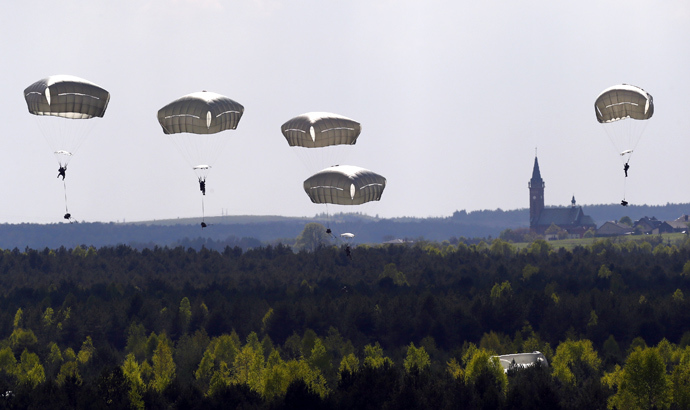 "Troops from the U.S. Army's 173rd Infantry Brigade Combat Team parachute during a NATO-led exercise ""Orzel Alert"" held together with Canada's 3rd Battalion and Princess Patricia's Light Infantry, and Poland's 6th Airborne Brigade in Bledowska Desert in Chechlo, near Olkusz, south Poland May 5, 2014 (Reuters / Kacper Pempel)"