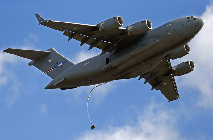 "A soldier from the U.S. Army's 173rd Infantry Brigade Combat Team parachutes from a Boeing C-17 Globemaster III during a NATO-led exercise ""Orzel Alert"" held together with Canada's 3rd Battalion and Princess Patricia's Light Infantry, and Poland's 6th Airborne Brigade in Bledowska Desert in Chechlo, near Olkusz, south Poland May 5, 2014 (Reuters / Kacper Pempel)"