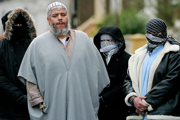 ARCHIVE PHOTO: A file photograph dated February 7, 2003 shows Muslim cleric Sheikh Abu Hamza (2L) outside the North London Mosque at Finsbury Park surrounded by supporters (Reuters)