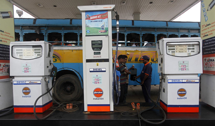 An employee fills diesel in a public bus at a fuel station in Kolkata, India. (Reuters/Rupak De Chowdhuri)