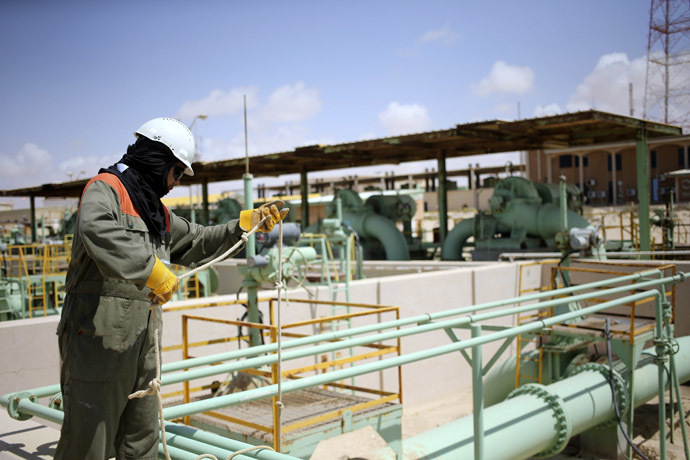 A worker maintains oil pipelines at the Zueitina oil terminal in Zueitina, west of Benghazi April 7, 2014. (Reuters/Esam Omran Al-Fetori)