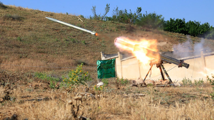 A missile is fired by Free Syrian Army fighters towards forces loyal to Syria's President Bashar al-Assad in the eastern Hama countryside May 14, 2014.(Reuters / Mohamad Bayoush)