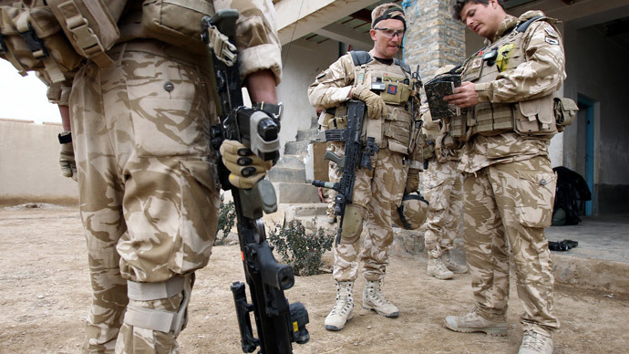 British soldier Lieutenant-Colonel Nick Lock (C) checks his equipment before conducting a patrol with soldiers of the 1st Batallion of the Royal Welsh in streets of Showal in Nad-e-Ali district, Southern Afghanistan, in Helmand Province.(AFP Photo / Thomas Coex )